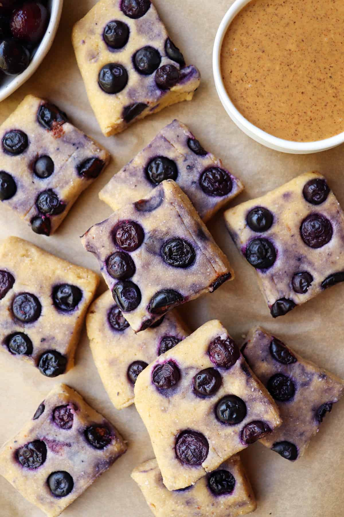 Top view of blueberry fudge bars stacked on top.