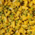 Very close up shot of cheesy carrot pasta.