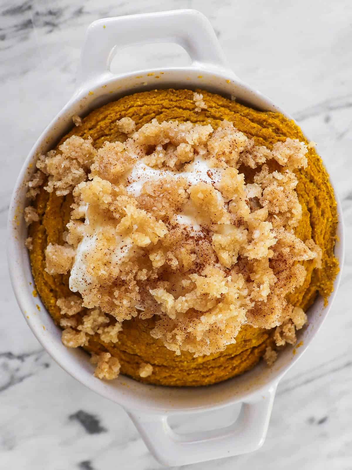 Cooked pumpkin mug cake with toppings.