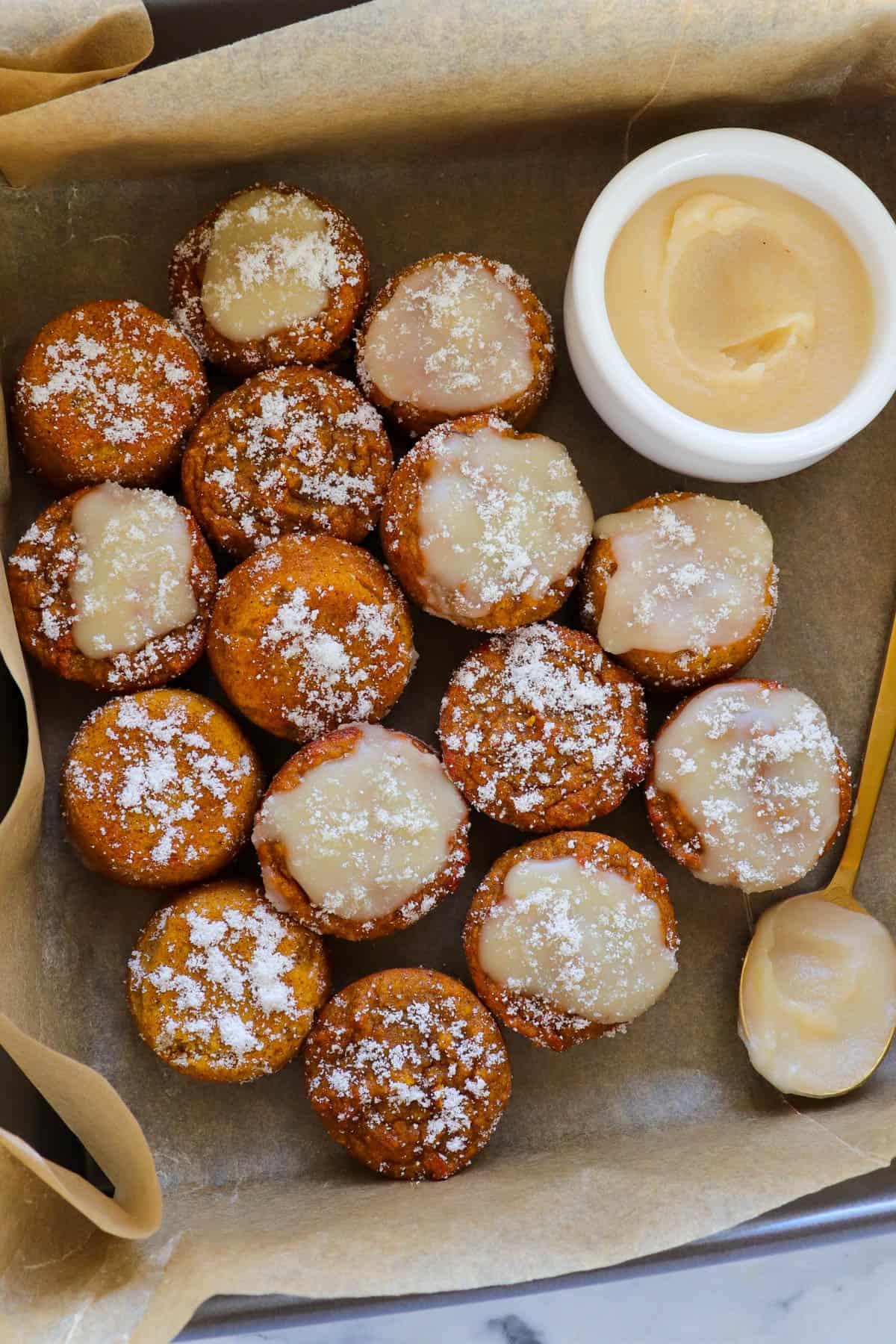 Pumpkin donut holes in baking box.