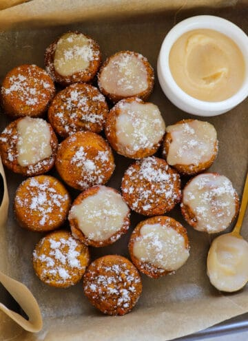 Pumpkin donut holes in baking box.