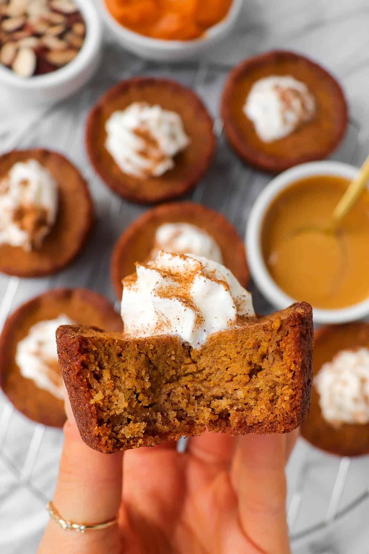 Bite shot of pumpkin pies in hand.
