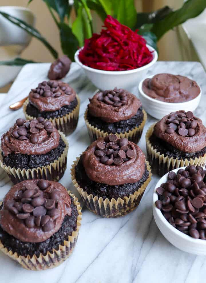 Chocolate muffins with chocolate frosting on top.
