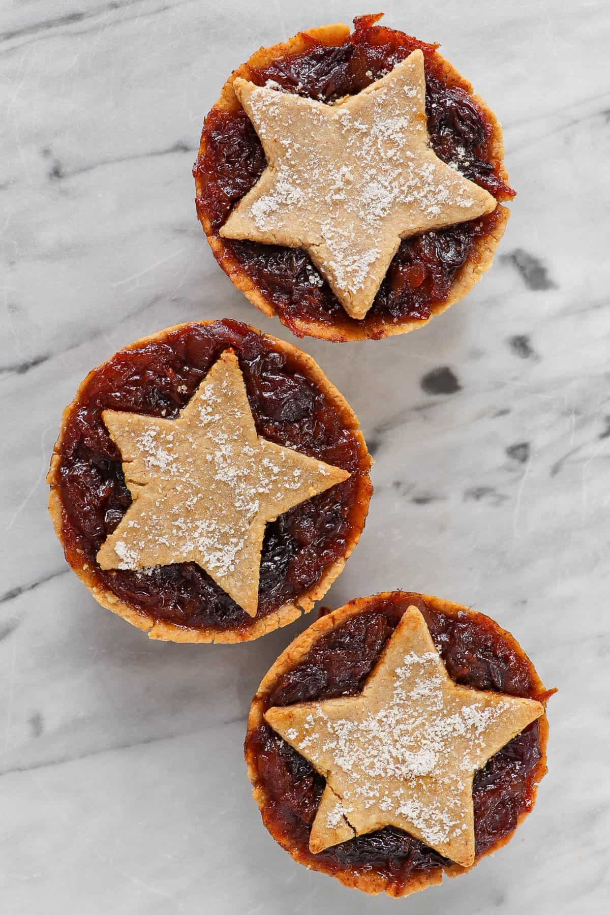 Three cooked fruit minces pies.