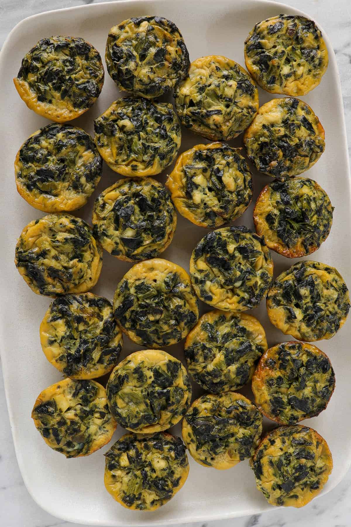 Quiches on a platter.