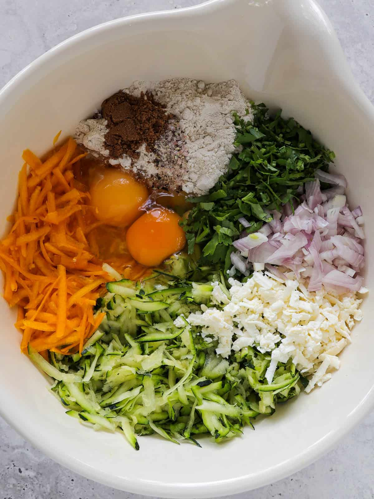 Fritter ingredients in mixing bowl.