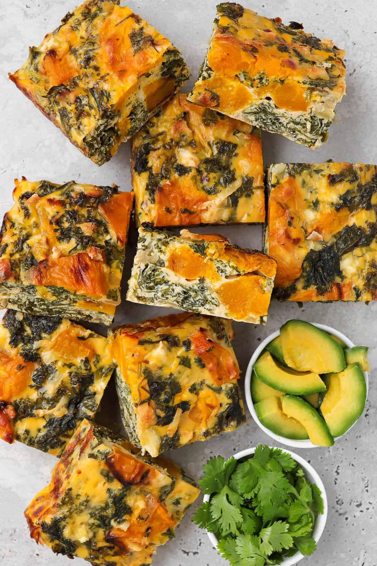 Sliced frittata with one piece on it's side for inside view.