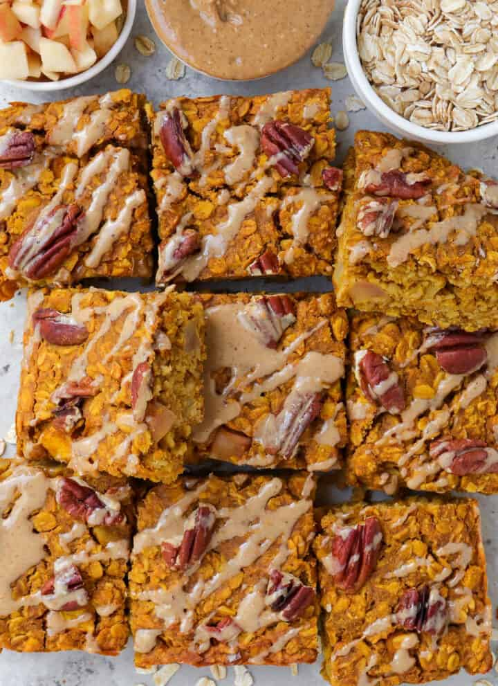 Top view of sliced up oatmeal bars with some tilted.